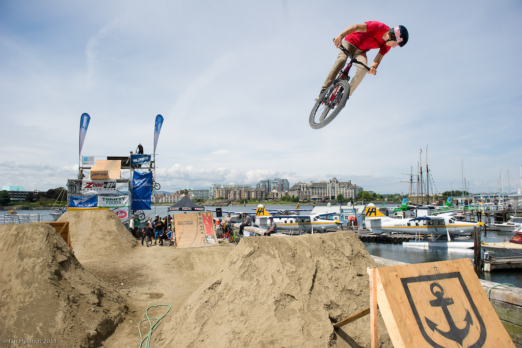 Brandon Semenuk with a huge 360 over the little jump on the back 9 during practice