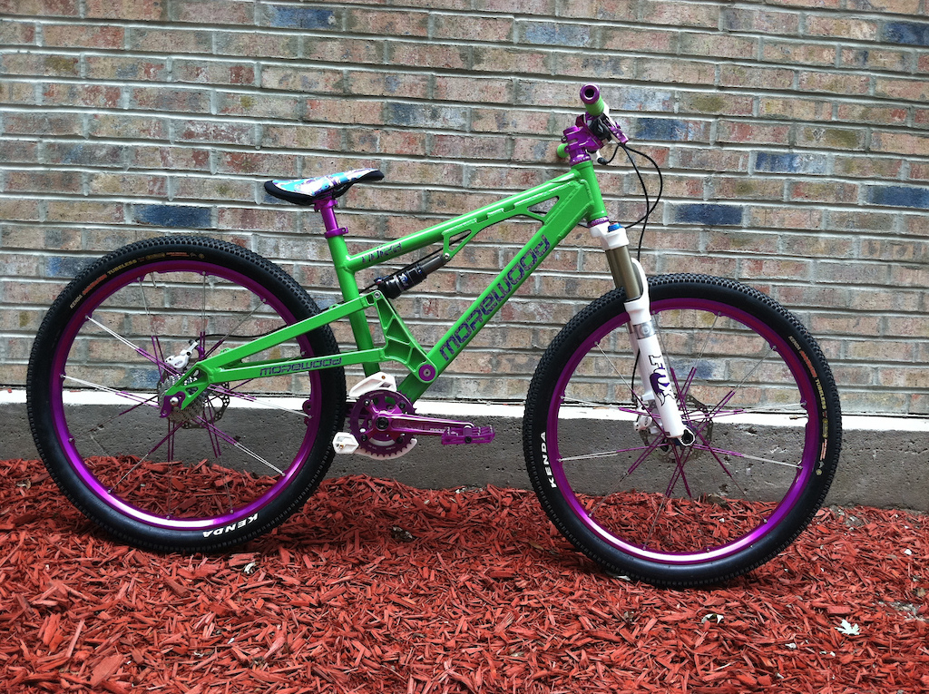 fresh powder and new decals.  custom purple crank brothers wheels, straitline stem, pedals, e13 backplate, linkage bolts and thomson seatpost.