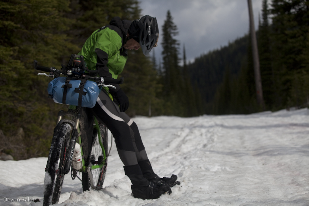 A rider takes a breather mid way through Stryker Pass 11 miles of snow.