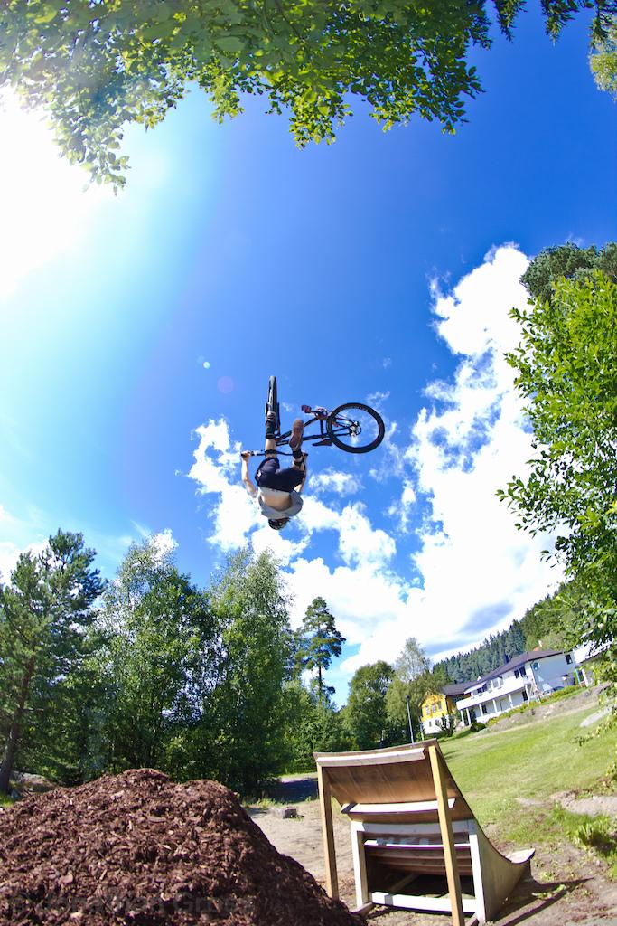 Sindre flipwhiping at his backyard jump.   Photo: Jonathan Gross