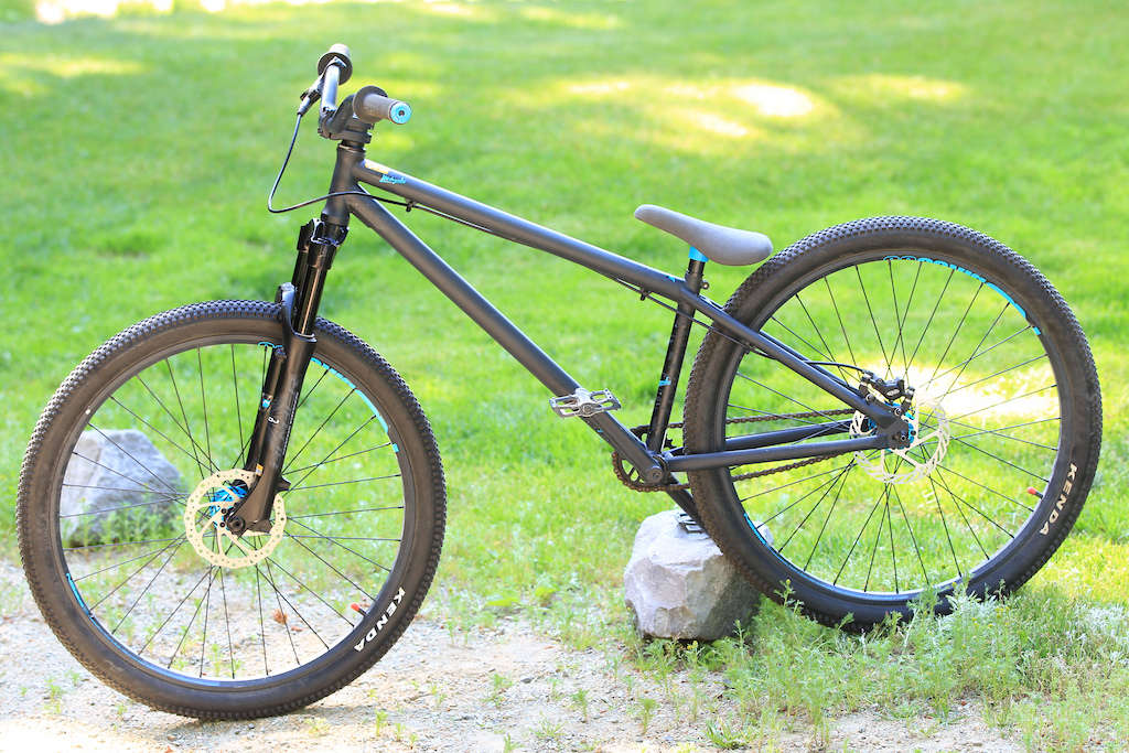 Kenda tires, Octane hubs and cranks, NS rims, NS stem and bars, Spank grips, Straitline pedals. Awesome shape, you'd think it was new.