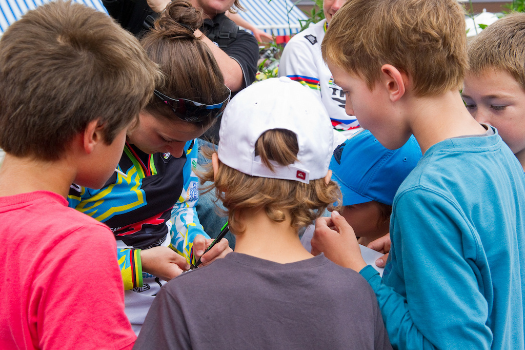 Racing a World Cup in Europe is a different animal than in North America. A public ceremony to introduce the top pilots saw the riders signing autograph after autograph from hordes of young fans.