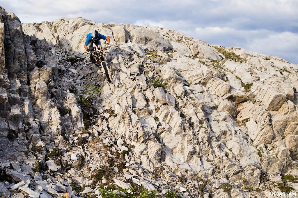 "The jagged rocks surrounding ""Money Shot"", one of Whitehorse's best DH trails, make for some interesting line choices.  Dan Barham photo - www.danbarham.com"