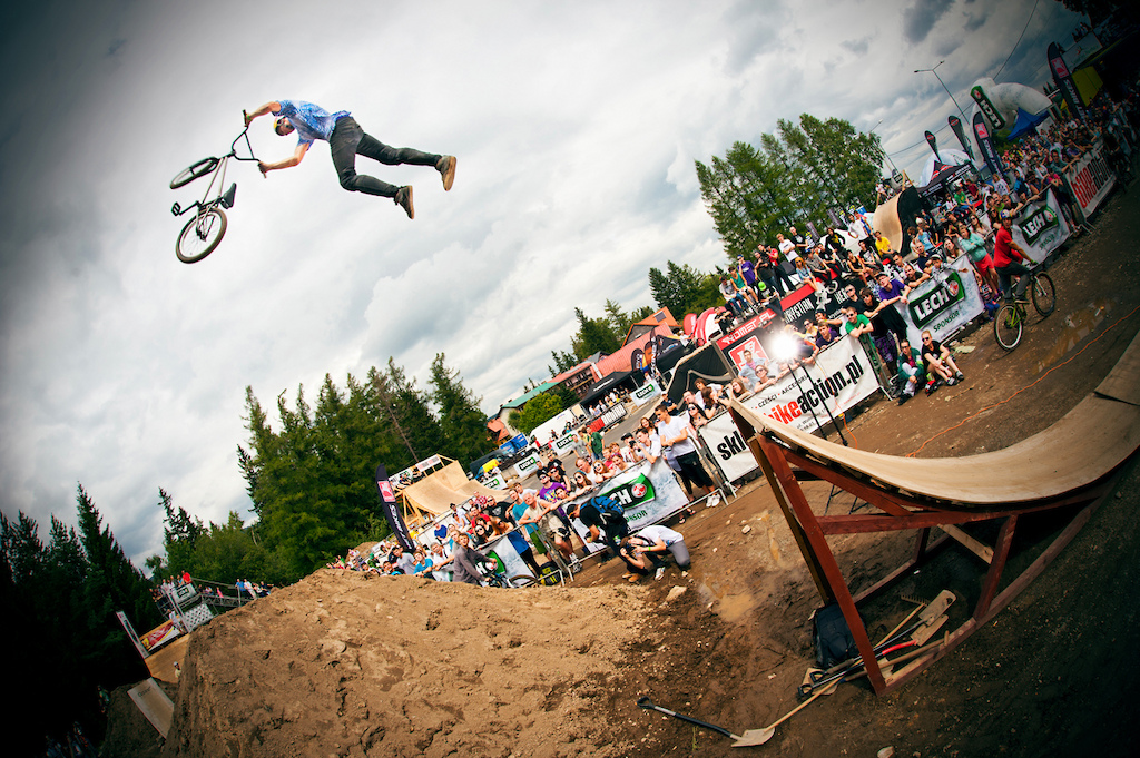"""Dawid """"Szamanek"""" Godziek with his Nami wins skatepark and dirt jump contests in BMX category during the biggest bike festival in Poland in Szklarska Poręba. He won also overall best trick competition with his triple tailwhip. Photo by Kuba Konwent - http://konwent.fotolog.pl/."""