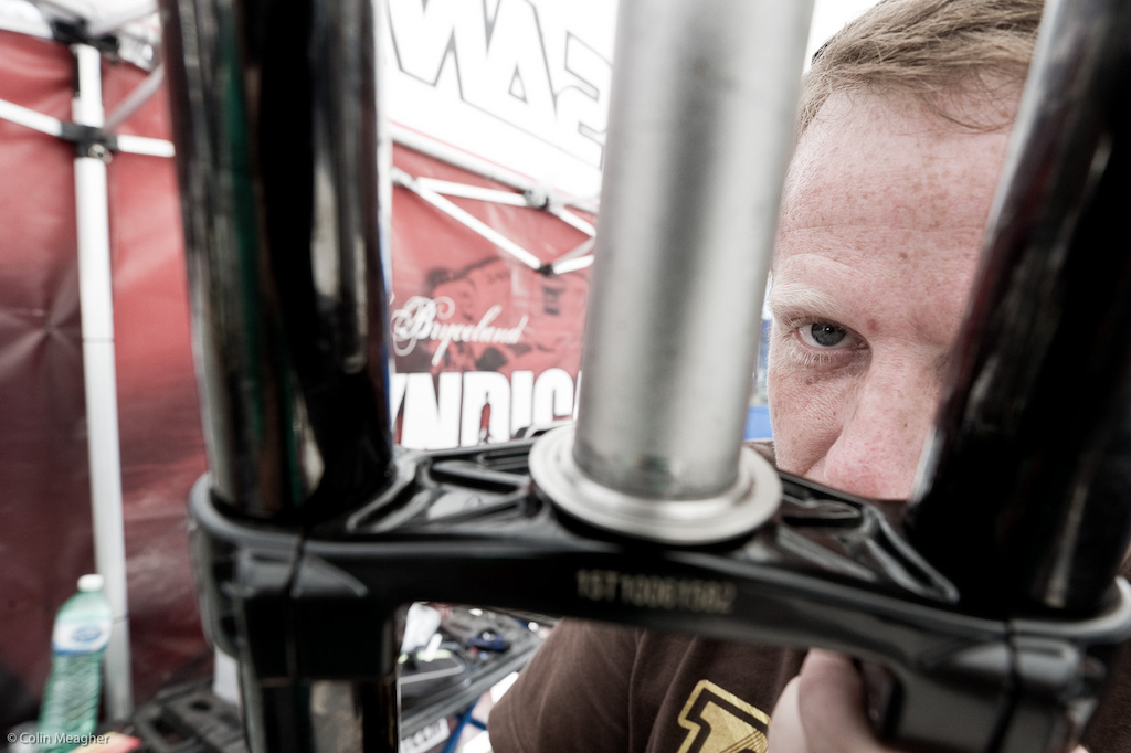 Bikes get a full head to toe before being re-built. Ricky Bobby Peaty s wrench gives the steerer on Mr Peat s steed a sharp eye. The crown race he eventually decided needed replacing. It s almost obsessive attention to detail like this that makes this team so damn good.