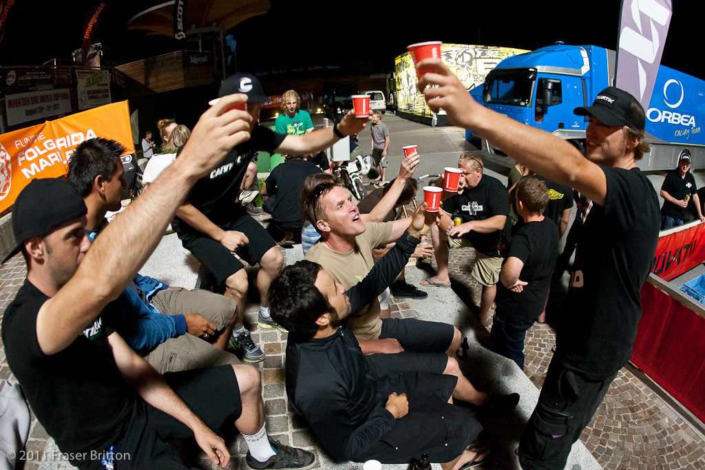 To Sram. Just a few of the dozens of SRAM sponsored teams mechanics' offer a toast. Jack knows how to party, Italian style. Flaming Sambuco shots in paper cups. Safety third.