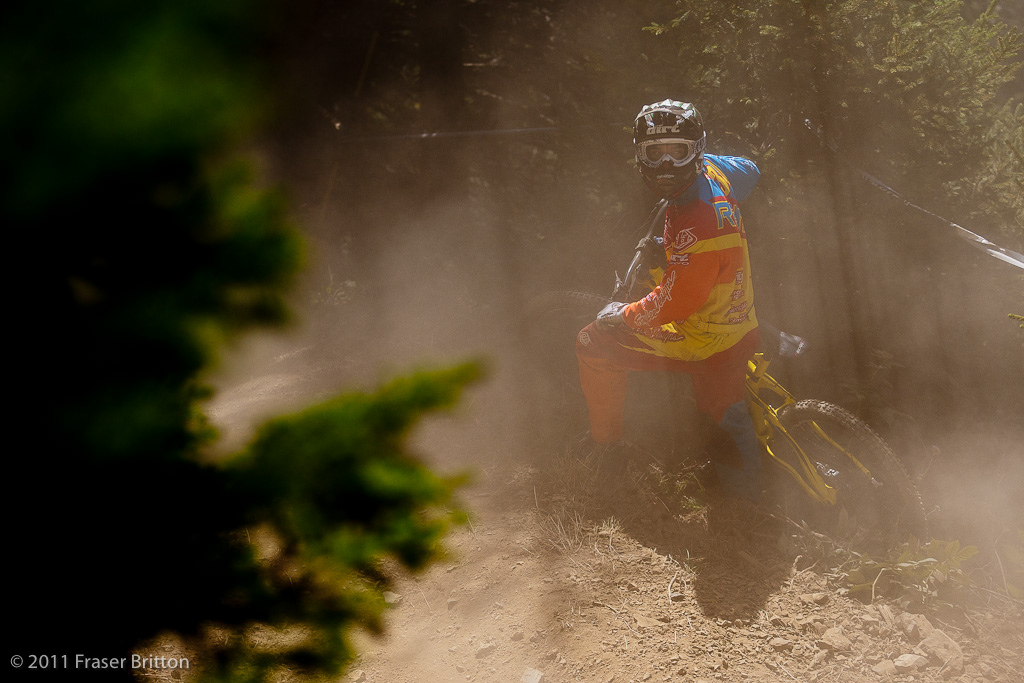 Ben Reid shows everyone what happens when you jump the hip to flat. Into the trees and a cloud of dust you go.