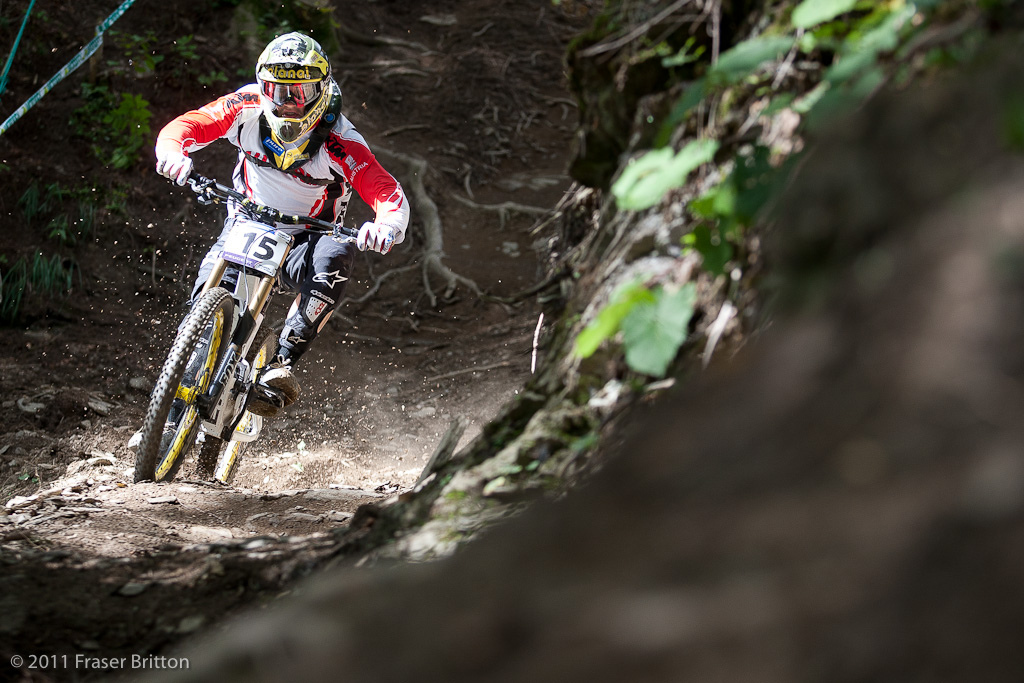 Markus Pekoll demonstrates how ridiculous the lighting conditions are in the woods. Imagine going from sunshine to complete darkness to spots like this... on the steepest track of your life.