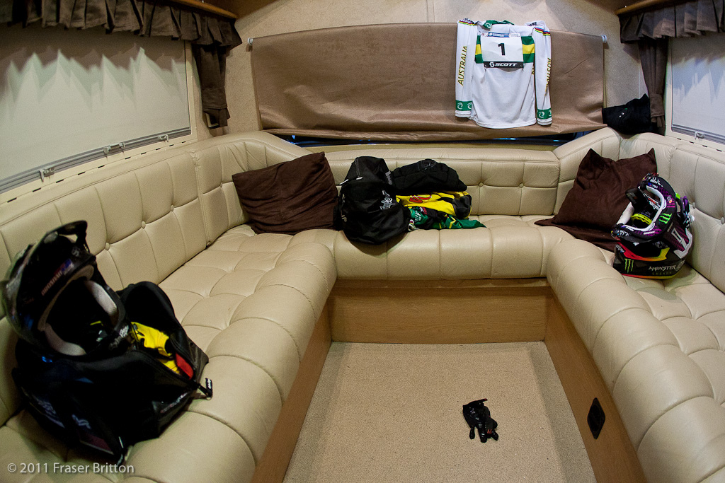 The inside of the Monster Energy Specialized team RV is organized and ready. 3 team kits lay in wait for their riders.