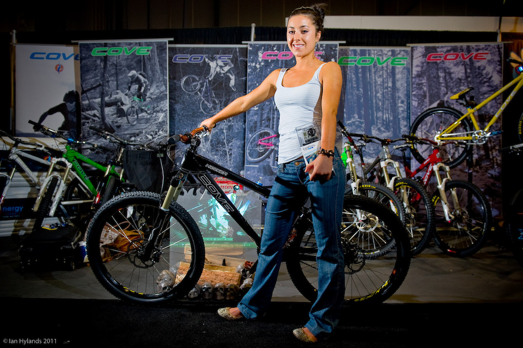 Holly poses with a black Hooker at the Cove Bikes booth.