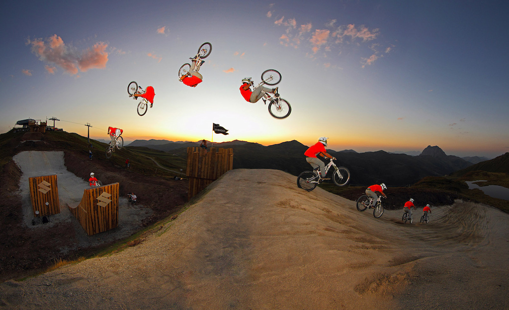 Bienve pulls a huge fronty nohander over the Suzuki Nine Knights MTB jumps during the last minutes of the sundown session... awesome event Re-upload - make sure to watch it in high res Photo c by www.larsscharlphoto.com me