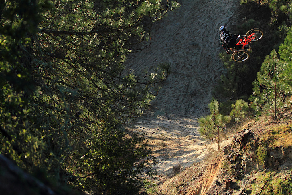T-Mac clicking a massive whip on his downhill bike for the Fox McCaul bros shoot.