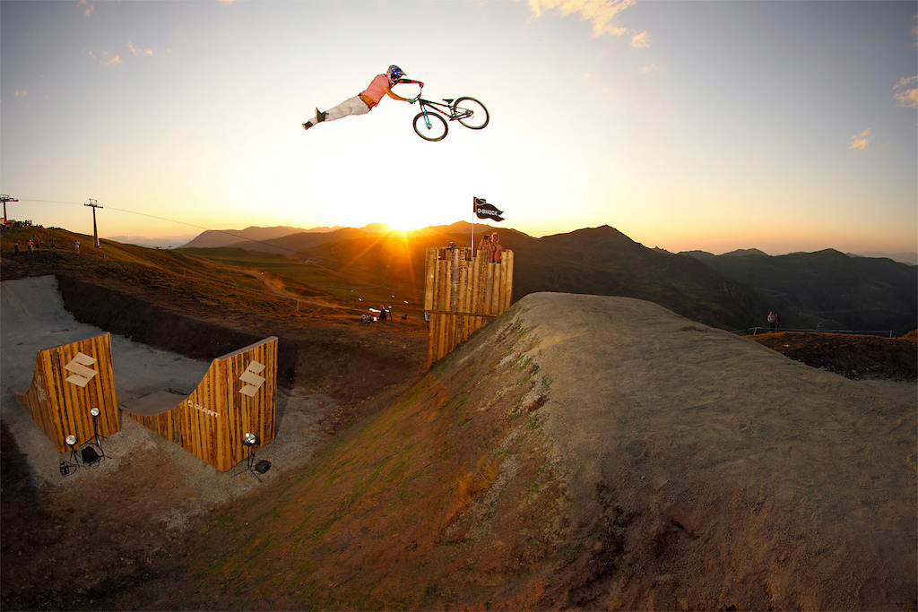 Martin pulls a huge superwhip over the Castle jumps at the 2011 Suzuki Nine Knights MTB event. Epic sundown session Make sure to watch it in high res photo c by www.larsscharlphoto.com me