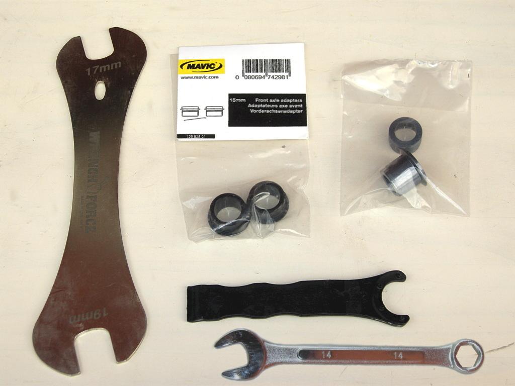 Things You'll need: (clockwise) 17mm cone wrench, Mavic 15mm front-hub endcaps, Mavic 142/12mm rear-hub endcaps, Mavic bearing adjust tool, 14mm cone wrench or open-end wrench.