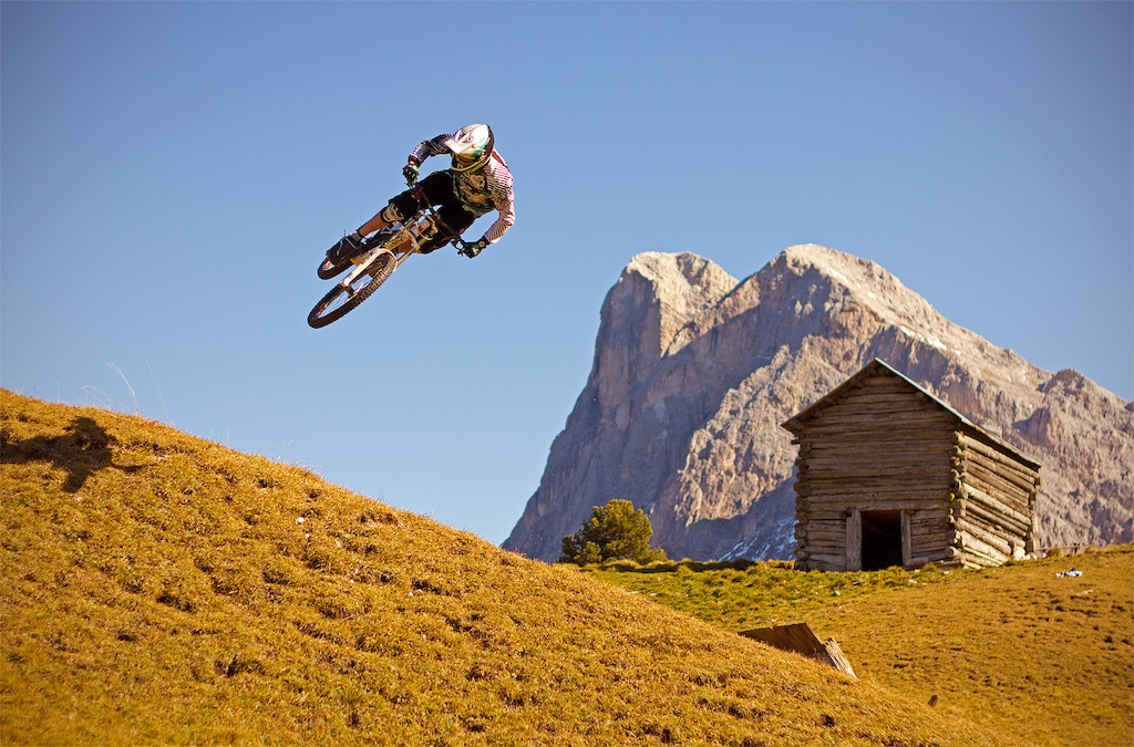 Fischi goes braaaap over a selfmade hip jump on his GHOST DH. Photo c by www.larsscharlphoto.com me