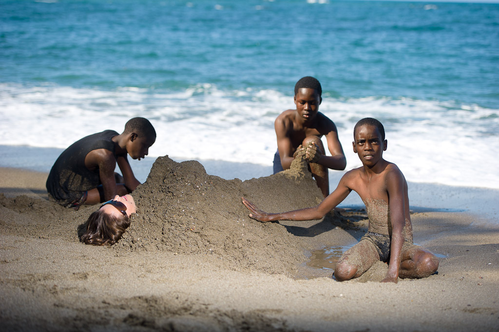Katie Holden Relaxes With Some Children At The Black Sand Beach Near Robins Bay In Jamaica