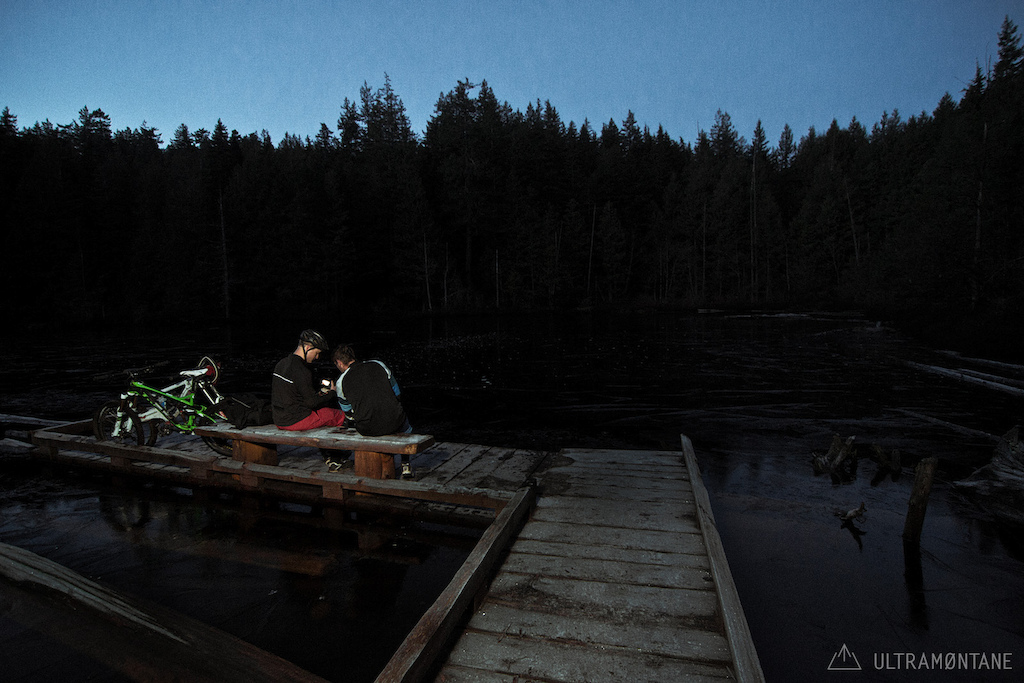 Reviewing footage at the lake after the days pedal.