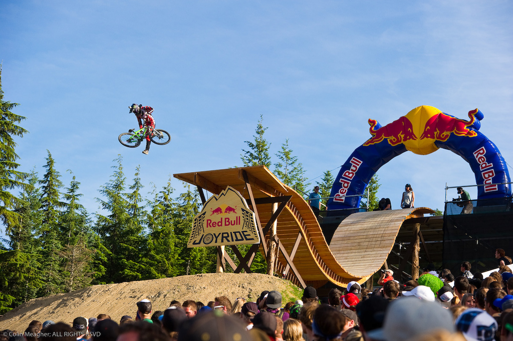 Mike Montgomery sending it at Crankworx. Every contender sent it off this drop but for this shot I opted to go for the crowd s perspective. Mike s the only rider I shot from this spot and while I really should have placed more of the crowd in the foreground to balance the subject I think that overall the shot works well. I just wish I had perhaps shot a few more riders from this vantage point. Next year...