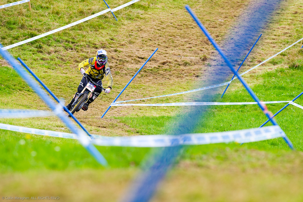 This was one of those moments where everything just lines up right Brook s body lean the course poles and tape framing the corner... When I got this shot and knew I had a winner.