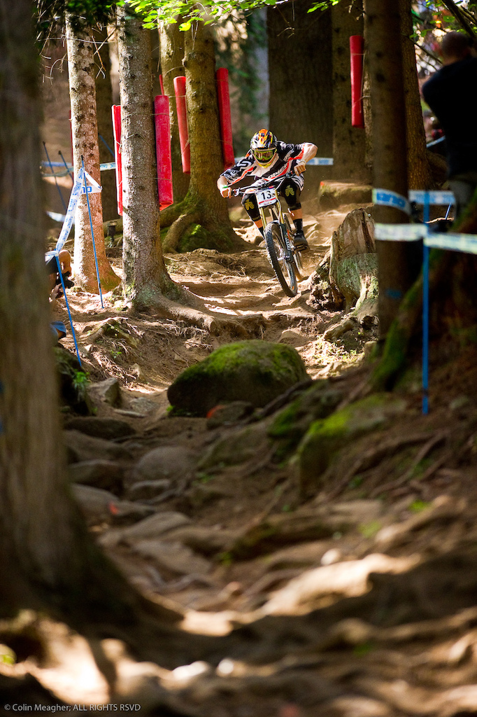 Val di Sole is right up there with Mount St Anne and Ft William when it comes to demanding a complete and focused rider a single mistake at a place like this can have massive consequences. As a photographer the most difficult thing at a place like this is finding a shot that illustrates not only how gnarly the track is but also how graceful and skilled the riders are. This shot of Blenki dancing through this rock and root infested gutter below the main rock garden is one of the few times in 2011 where I feel I truly nailed it.