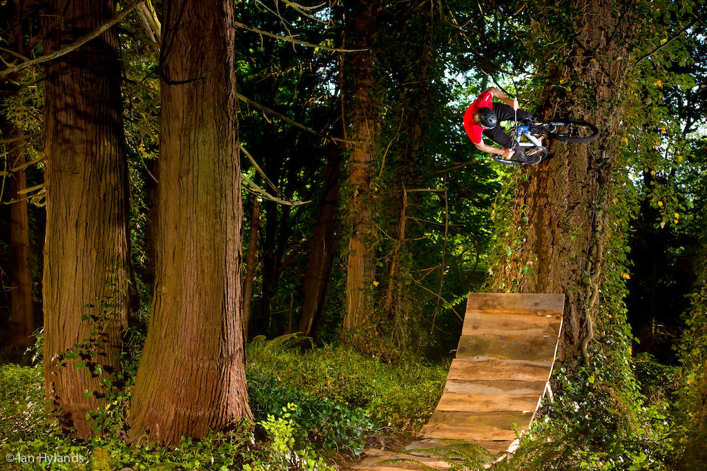 Billy Lewis tire taps a tree in the enchanted forest somewhere in the Pacific Northwest.