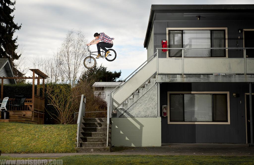Hand rail/ stair gap near Greenlake. Josh Monteith goes big. © Paris Gore 2012