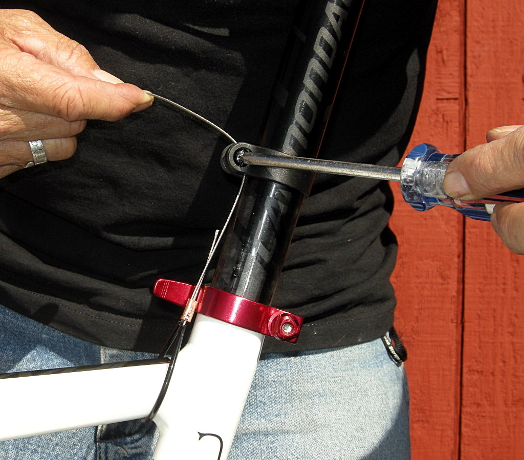 You may have to loosen the seatpost collar to thread the cable through.