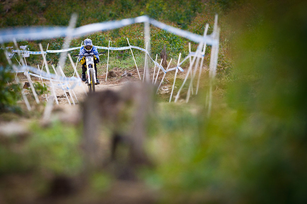 First Day of practice for CRC Nukeproof at the 2012 World Cup DH in South Africa and Matt Simmonds is straight into the speed tuck!  Photo by MTBcut's Sebastien Schieck