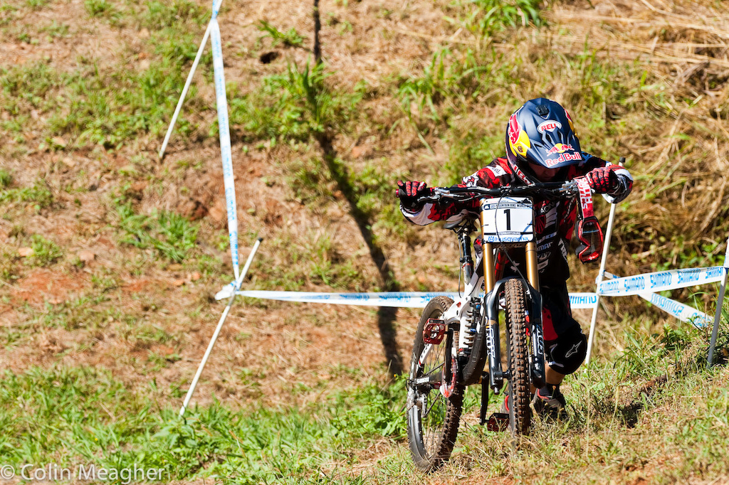 Aaron Gwin hikes back up the course in practice at the Pietermaritzburg UCI World Cup DH