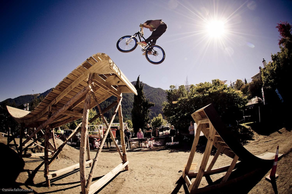 Part time local Kiwi Pete Miller with a x-up onto the fruit bowl at the 2012 Queenstown Bike Festival Teva Slopestyle