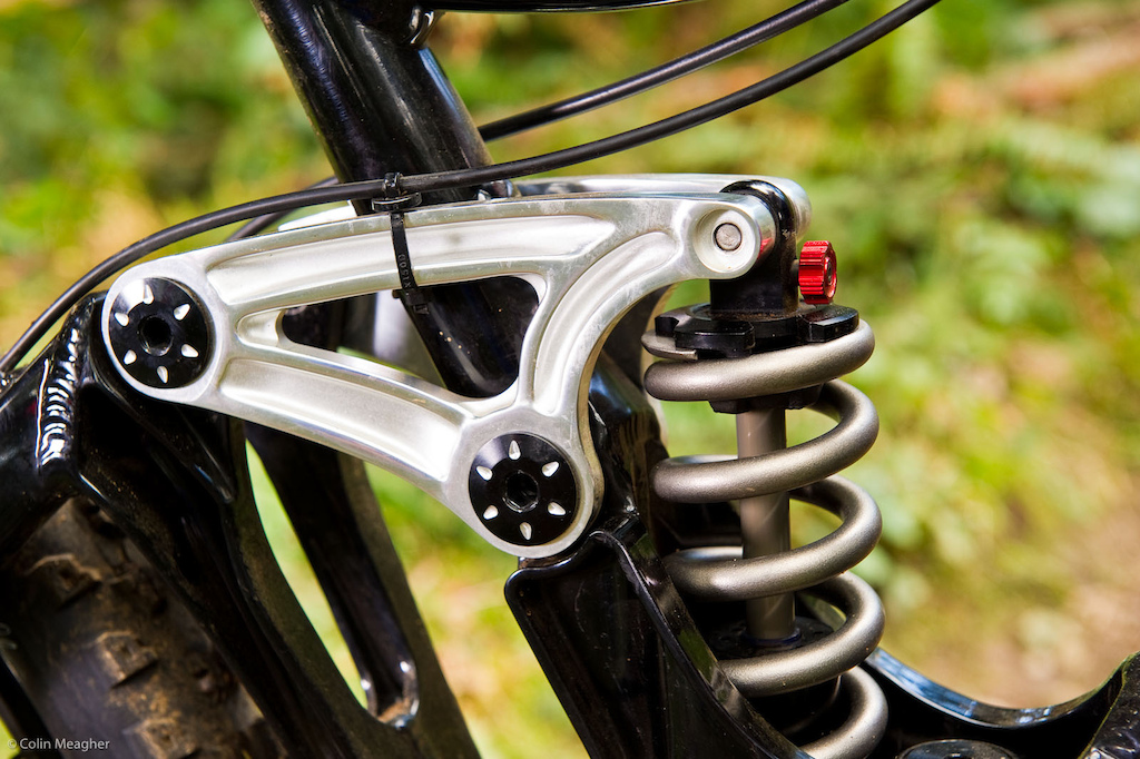 Suspension in the back is maintained by a Rockshox Kage shock with a 450lb ti spring. The upper rockers ride on 16mm pivot pins to increase frame stiffness.