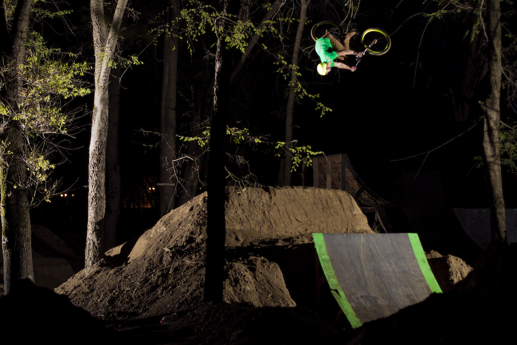 Night flatspin over the second jump in a line. Photo by Alex Bivol