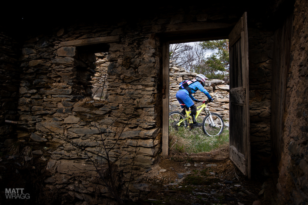Valentina Macheda descending through the ruins in the forest.