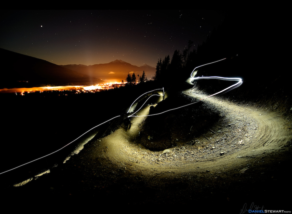 Stuart Dickson riding a new trail built in a cut-block at night on Boulder Mountain, Revelstoke, BC.
