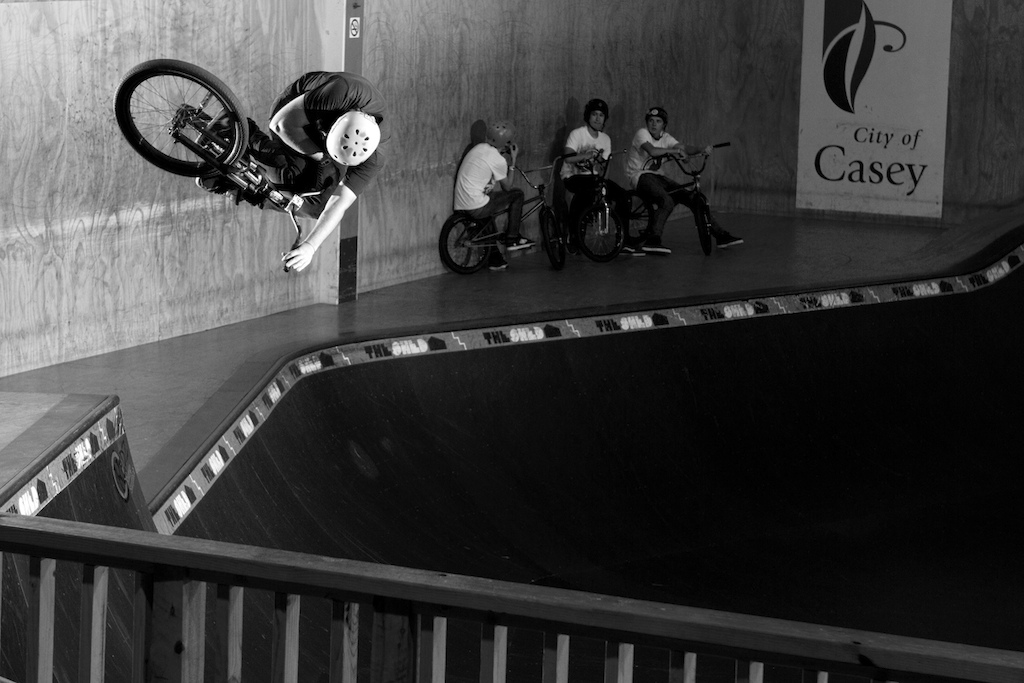 Aaron blasting a super clicked table in the deep end of the bowl