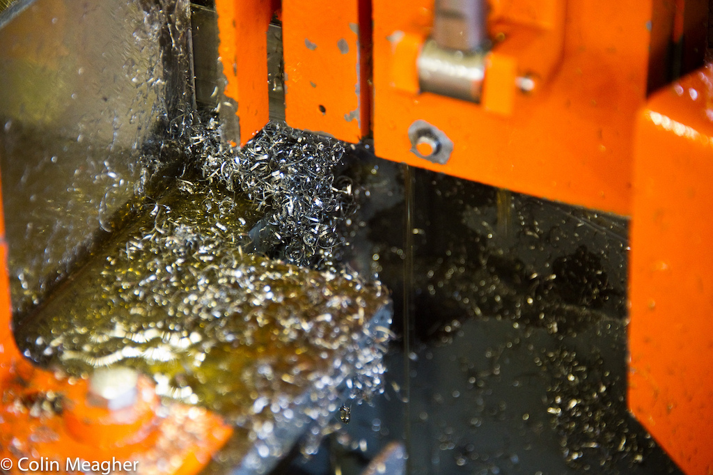 At the end of the day it s not only the human touch that defines Chris King s approach to manufacturing his components but the responsibility for that manufacturing process. Every piece made creates waste metal and waste cutting fluid - in the image pictured here steel shavings called chips and soy oil. King uses sustainably grown domestic soy oil exclusively as a cutting fluid and as lubrication for the machines in his factory. But this fluid coats each and every chip making them difficult to recycle.