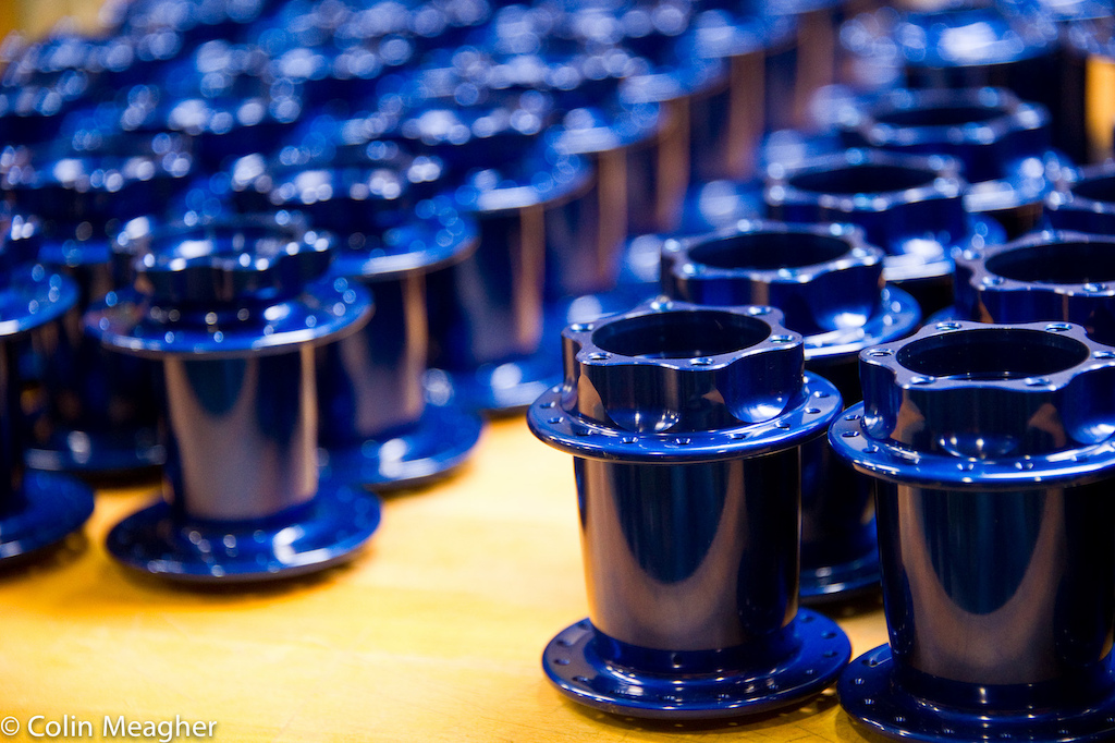 Blue jewelry freshly anodized disc hubshells in queu for laser etching. Anodizing is currently the only process that CK outsources to one of two local companies . Anodizing is not an environmentally friendly process but CK is currently working on bringing that process back in-house in order to utilize a closed process to limit environmental harm.