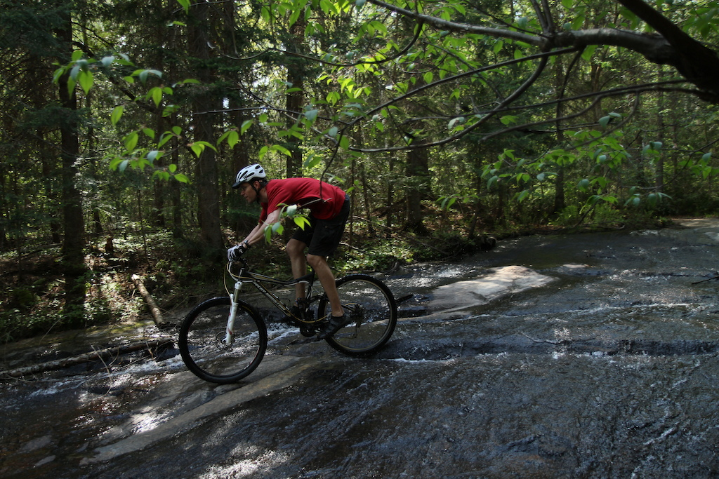Hunting for single track over the Victoria Day long weekend ended up revealing some amazing terrain in North Bay. Riding this shallow waterfall was how I cooled off and washed my bike at the end of the ride.