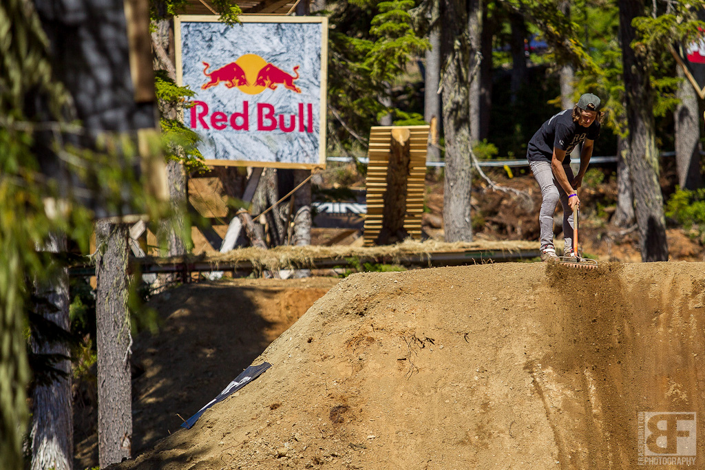 The reigning king of slope style Brandon Semenuk lends a hand and picks up a rake Friday morning to help get the course dialed.