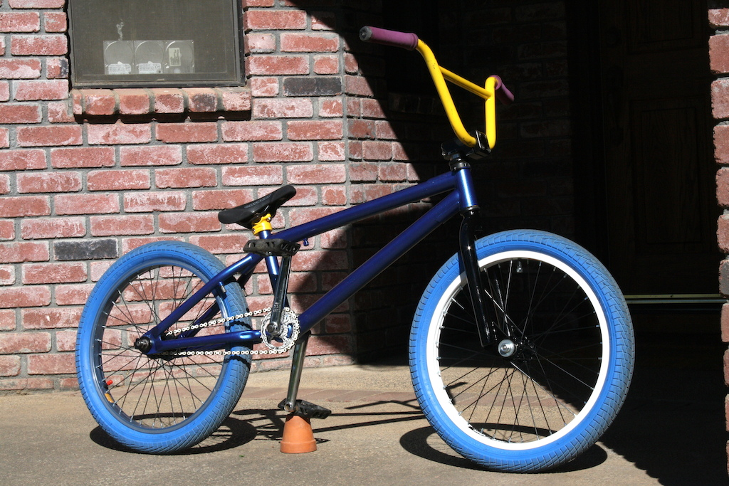 Just painted the frame and forks Metallic midnight blue frame and glossy black forks. Going to get whitewall tires instead of the blue ones on right now.