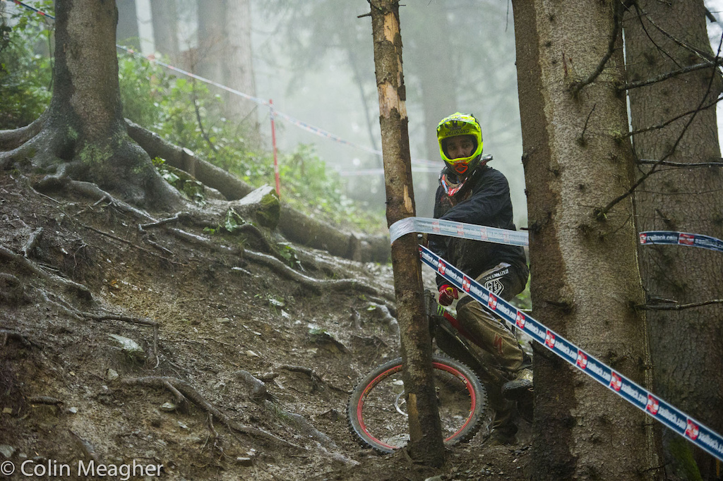 Scouting for sniper lines in the rain... Sam Hill was the last rider down the hill today.