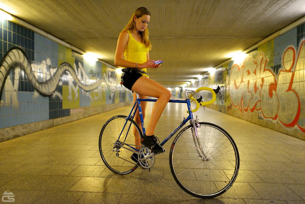 Kat takes a WhatsApp break on a vintage Eddy Merckx, Munich, September 2012.  Nikon D800 & Nikkor 24mm 1.4 @ 1.4