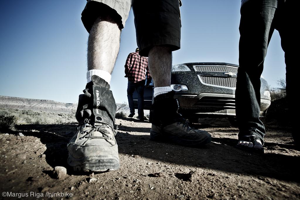 Smart man footwear vs dumb man footwear. Good luck with those flip flops.