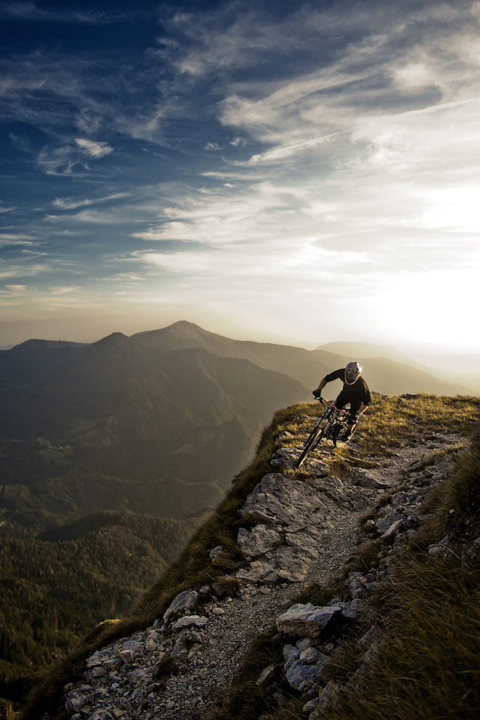 Riding with full speed, on the edge of 200m drop is pretty gnarly! Specailly with the sunset behind you.