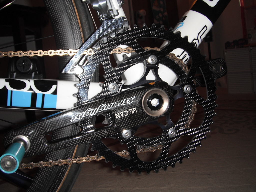 Stronglight crank, customized carbon fiber chainring made by fibre-lyte of Germany, and Aerolite pedal