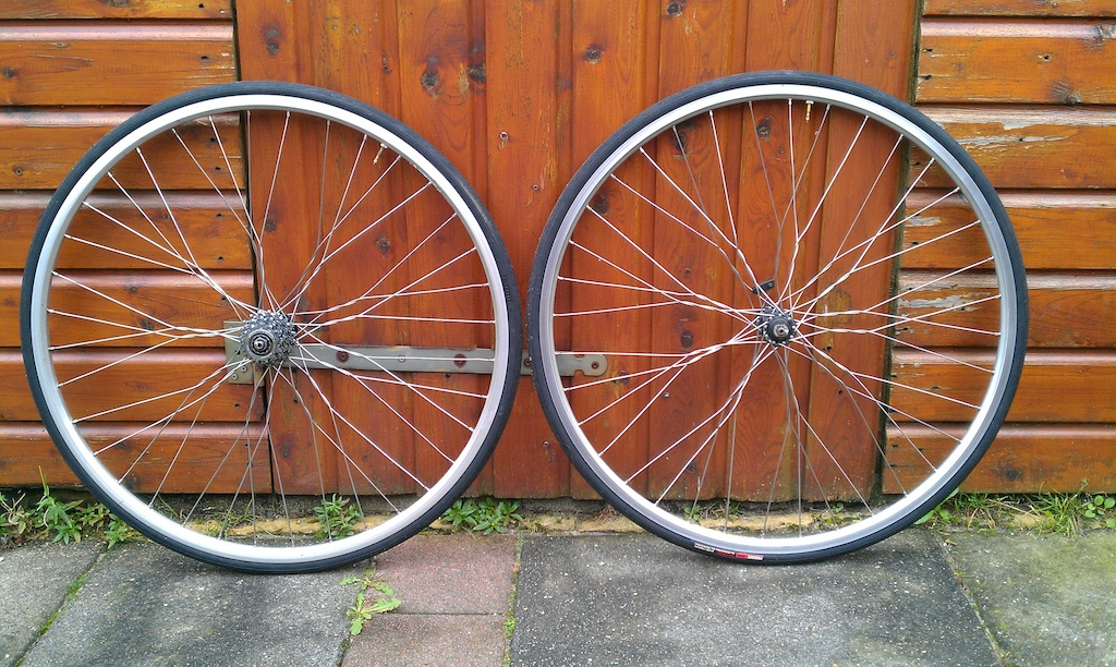 "28"" hybrid wheels with Deore LX hubs and ""Twisted Spokes"". Comes with tyres but NO cassette."