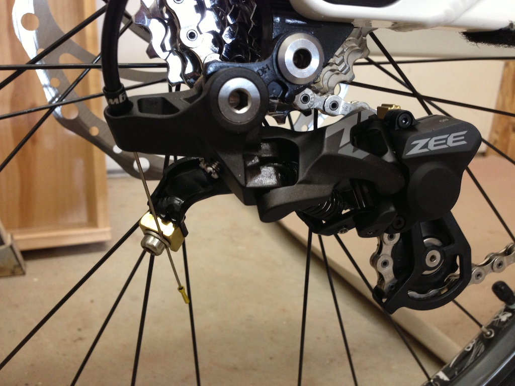 "Shadow plus mod.  9spd sram shifter and drivetrain. 1/4""washer with slot for cable cut down to .236"""