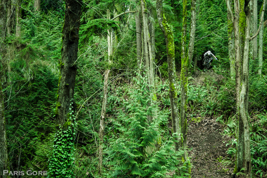 Massive float away step down outside of Seattle. On location filming with Shifted Cinema. Best part is, the landing is completely blind while standing at the lip due to the large amount of ferns engulfing the hillside. -www.parisgore.com-