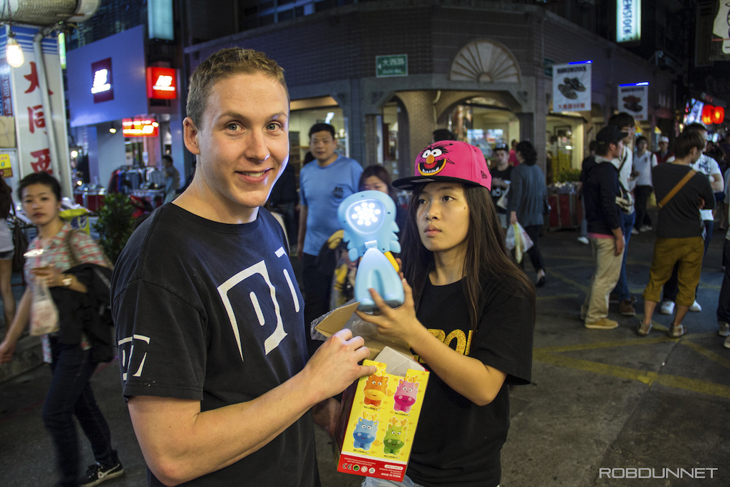 Mike won a lamp at the ring toss. He is pretty happy about his win how do you think she feels about the win