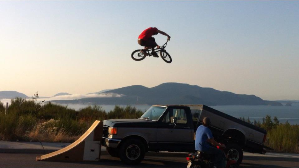 Ramp to truck bed!  super gnarly landing.  Yes he wears a helmet!  Photo by Richy Holman